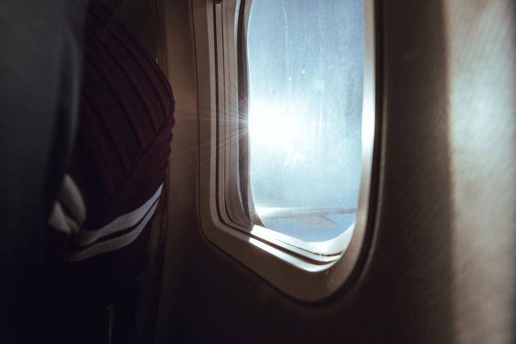 Close-up of window in airplane