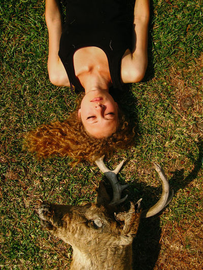 Hairstyle Land Field Young Adult Portrait Front View Lying Down Grass Lying On Back Nature High Angle View Woman Women Portrait Of A Woman Deer Taxidermy Animal Animal Head  Girl Nature Creepy Weird Beautiful Woman Dead Animal Strange