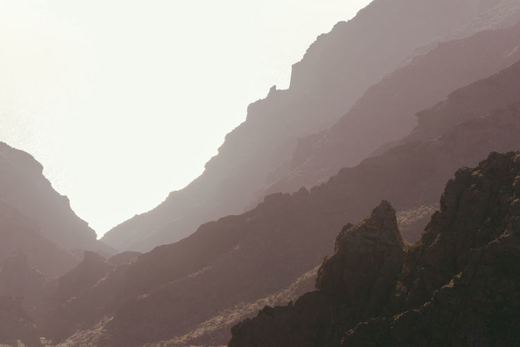 The textures of Tenerife Mountain Beauty In Nature Mountain Range Tranquility Nature Tranquil Scene Scenics - Nature Sky Rock No People Non-urban Scene Fog Rock - Object Day Geology Environment Physical Geography Outdoors Mountain Peak Formation Eroded Tenerife Tenerife Island 17.62°