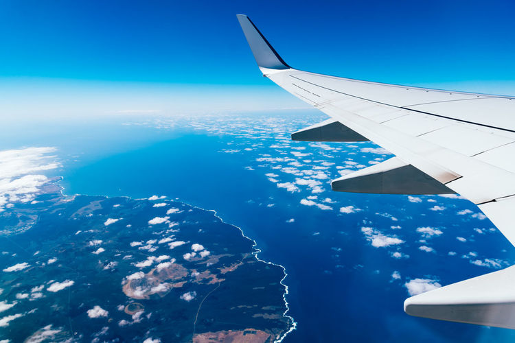 Airplane wing flying above island Canary Islands Travel Aerial View Air Vehicle Aircraft Wing Airline Airplane Airplane Wing Blue Day Flying Ground High Angle View Journey Landscape Mid-air Mode Of Transport Nature No People Ocean Outdoors Scenics Sea Transportation Travel