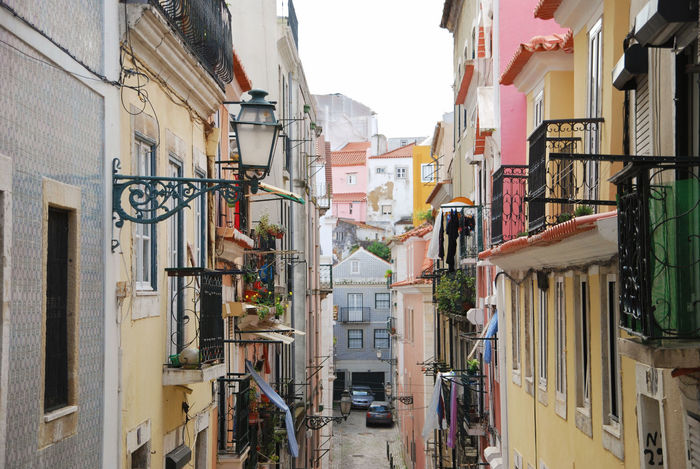 Architecture Bright Bright Colours Building Exterior City Day Drying House Laundry Lisboa Lisbon No People Old Town Outdoors Pastel Colors Portugal Romantic Street Street Lights Sunset Tourism Travel Travel Destinations Warm Colours Lost In The Landscape