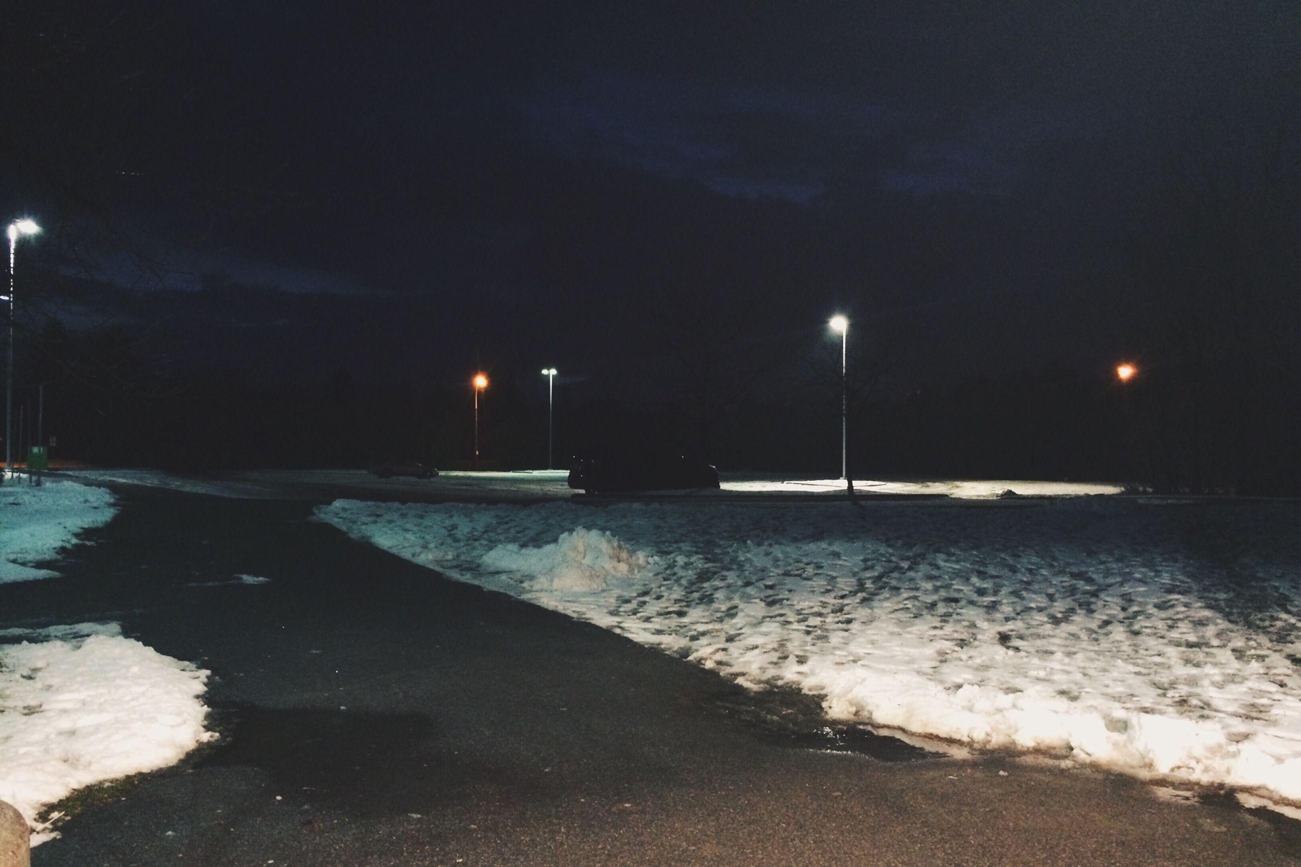 night, street light, snow, illuminated, winter, cold temperature, weather, street, lighting equipment, road, season, sky, transportation, dusk, nature, the way forward, outdoors, tranquility, frozen, silhouette