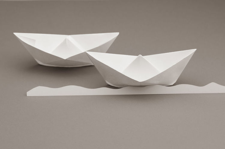 paper sail boats backdrop Art And Craft Close-up Copy Space Craft Creativity Folded Gray Gray Background High Angle View Indoors  No People Origami Paper Paper Boat Simplicity Single Object Still Life Studio Shot Table White Color