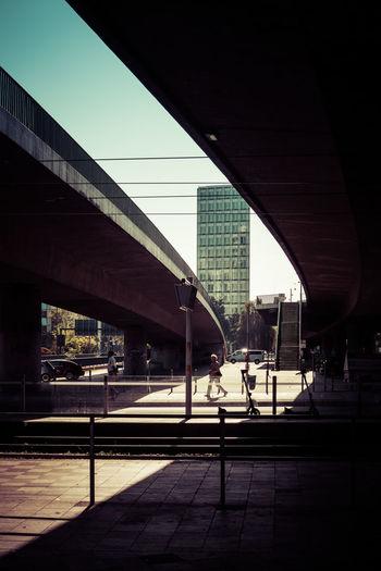 People walking on railroad station platform against sky
