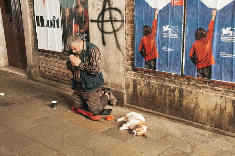 A lonely place to stay Graffiti Day Street Art Outdoors One Person Street Streetphotography Street Life Dogs Of EyeEm Homeless Homeless Or Just Chillin' Anarchy Streetart/graffiti Stories From The City