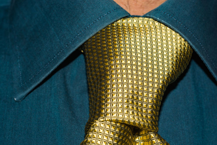 Midsection of man wearing necktie