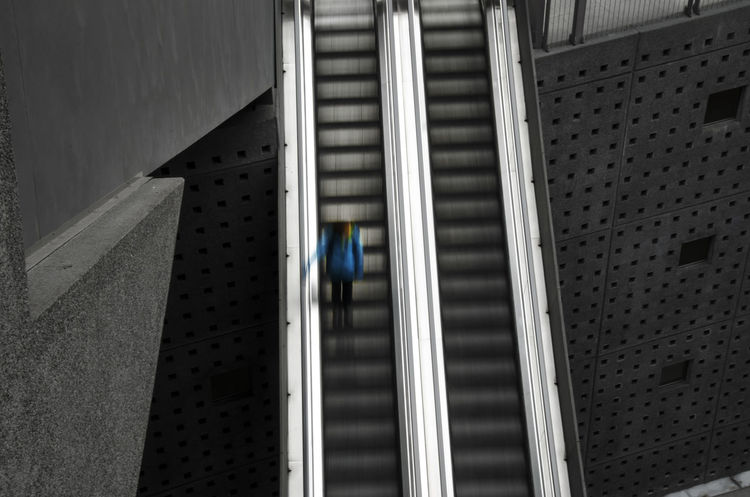 Central Station Escalator Architecture Blackandwhite Blue Built Structure Day Downwards Escalator Indoors  Low Angle View Moving One Person Pattern Staircase Station Steps Steps And Staircases Walking The Architect - 2017 EyeEm Awards EyeEmNewHere