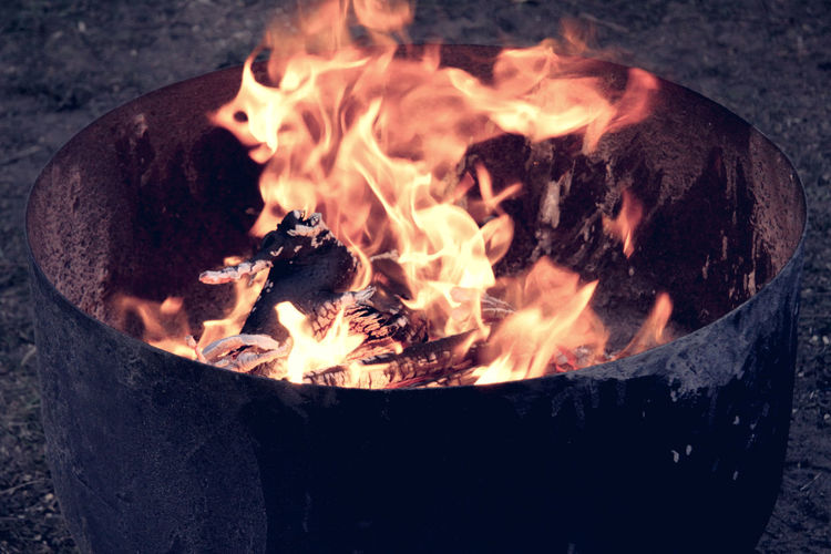 Close-up of fire pit on field at night