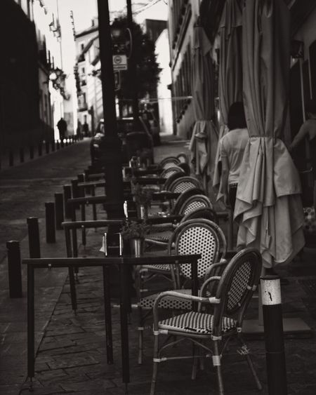 Man in empty chairs