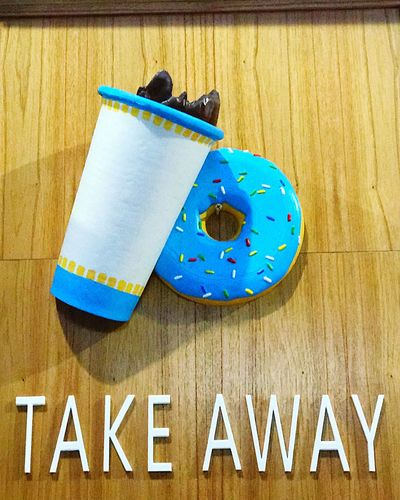 Take away Take Away Cups Take Away Coffee Take Away Food Take Away Coffee Donuts Text Blue Western Script No People Communication Wood - Material Multi Colored Group Of Objects Wall - Building Feature Yellow Creativity Hanging Directly Above Sign Art And Craft Close-up Indoors  Day Capital Letter