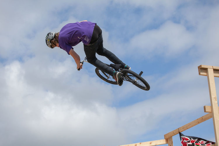 BMX Stunt riders in competition Adrenaline Adrenaline Junkie Aerial Bicycle Bike Bmx  BMX Contest Bmx Is My Life BMX ❤ Bmxlife Extreme Sports Flying Leisure Activity Lifestyles Liverpool Low Angle View Mid-air Motion Outdoors Rider RISK Stunt Stunt