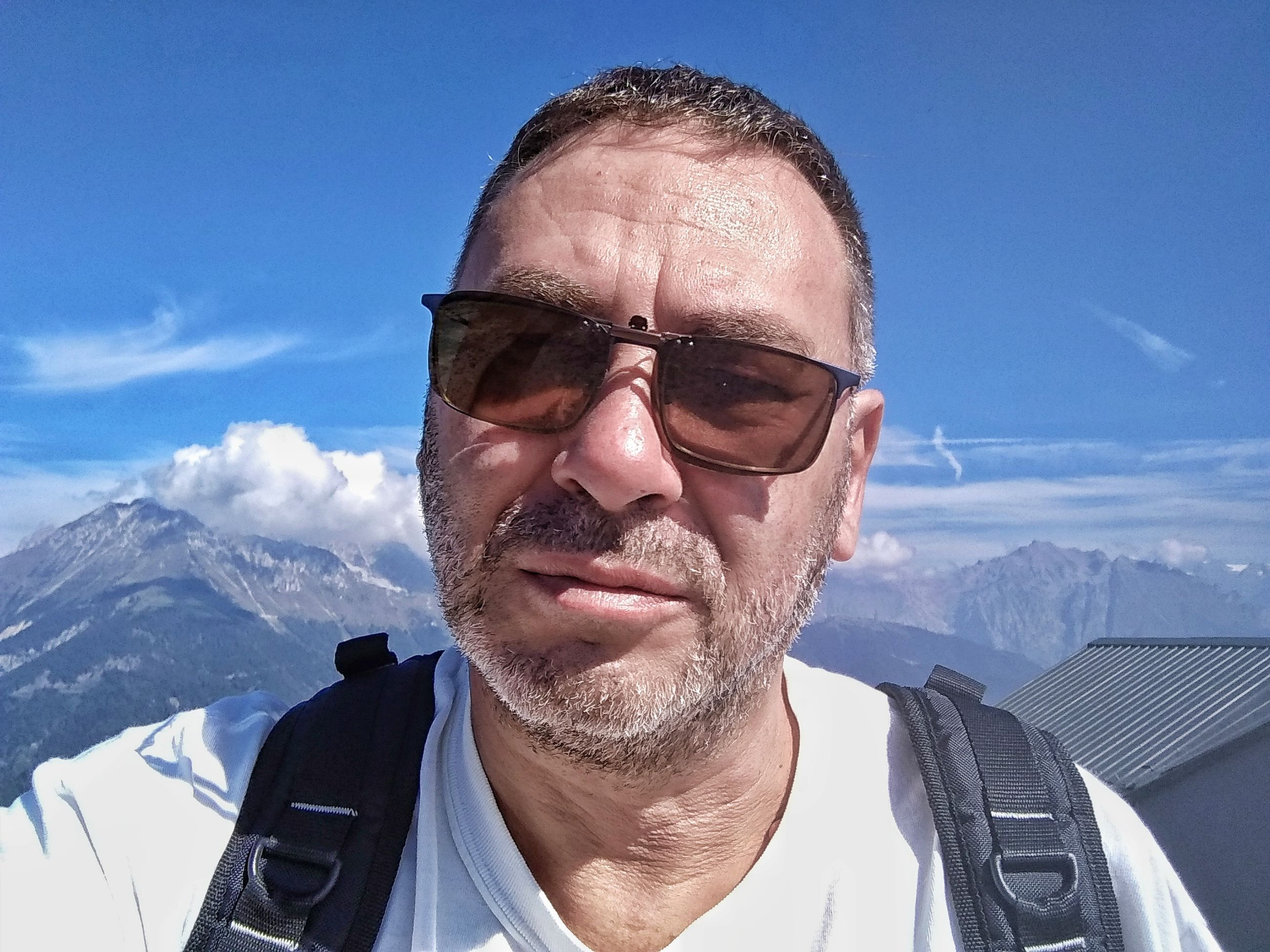 portrait, sky, males, real people, men, winter, mountain, leisure activity, one person, lifestyles, front view, mature men, mid adult men, headshot, glasses, nature, looking at camera, snow, mature adult, mountain range, outdoors, snowcapped mountain