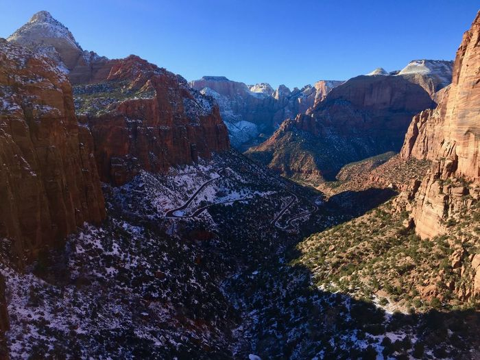 Scenic View Of Rocky Mountains Against Clear Sky At Zion National Park During Winter