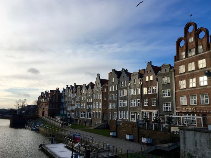 Panoramic View Of Residential Buildings Against Sky