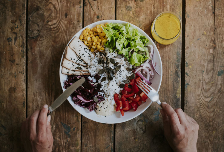 Eating Salad Vegetarian Food Bowl Directly Above Food Food And Drink Freshness Healthy Eating Healthy Lifestyle High Angle View Human Hand Indoors  Lifestyles Meal One Person Table Tofu Vegan Wellbeing