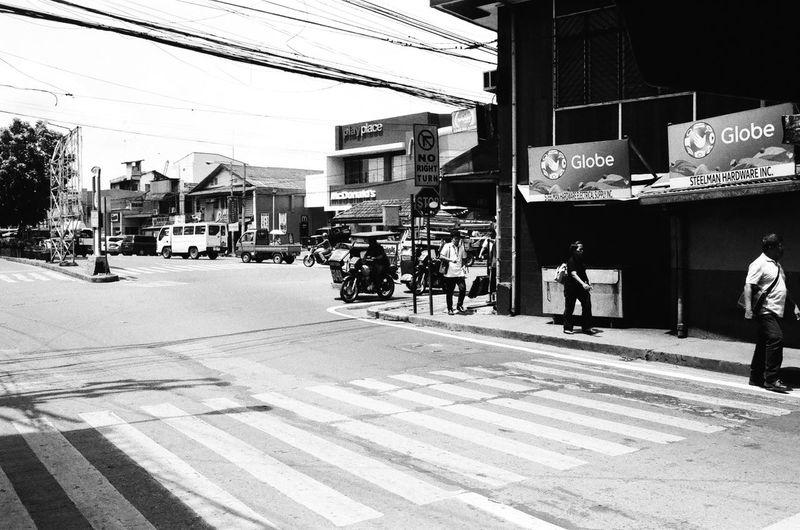 everyday streets 35mmfilm Asahipentaxspotmatic City City Life Day EyeemPhilippines Filmisnotdead Kodaktmax400 Outdoors Road Smctakumar35mm3,5