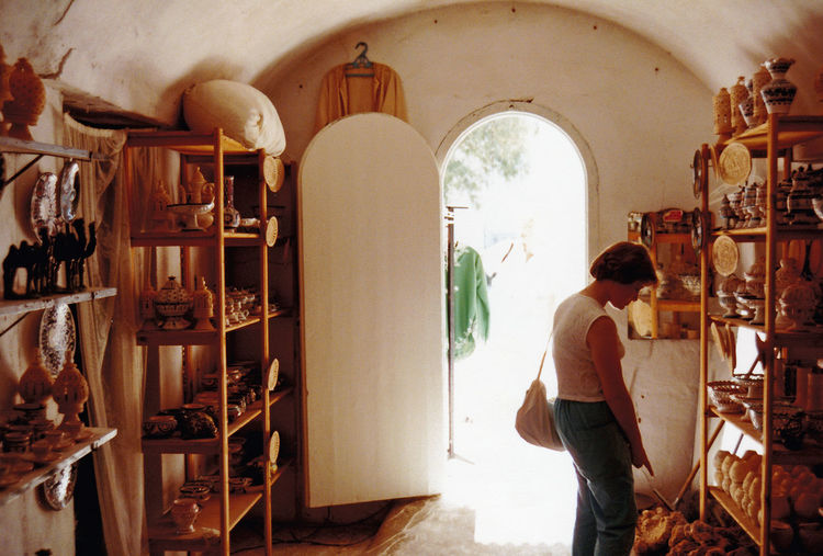 Tyical craft shop in Hammamet, Tunisia Architecture People Real People Women Rear View Day Standing Shelf Indoors  Medina Lifestyles Full Length One Person Hammamet Tunisia A Taste Of Tunisia Tunisian Hotels Craft Shop