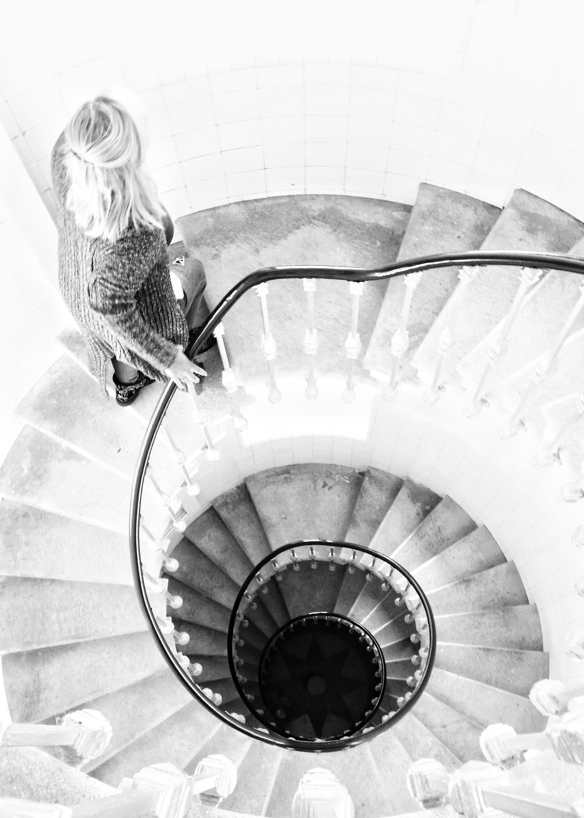 one person, high angle view, real people, lifestyles, women, steps and staircases, indoors, railing, staircase, architecture, full length, adult, spiral, spiral staircase, leisure activity, females, built structure, child, day, hairstyle