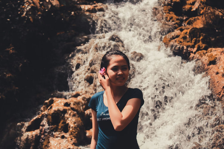 Beauty of Indonesia Ofpeople One Person Standing Water Smiling Day EyeEm Selects Young Women Happiness Outdoors Nature Waterfall Love Photography Beauty In Nature Beauty Happy Like4like Likeforlike Likes Rate Me Rate