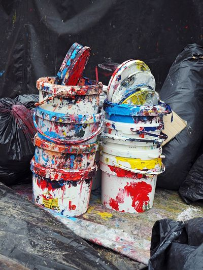 Stack Of Empty Colorful Paint Buckets