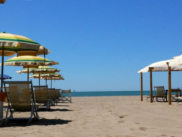 The Essence Of Summer Relaxing Beach Parasol Chairs Showcase June