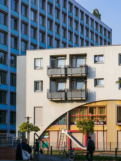 URBANANA #urbanana: The Urban Playground Ehrenfeld Apartment Architecture Available Light Building Building Exterior Built Structure City City Life Day Group Of People Lifestyles Men Modern Nature Office Building Exterior Outdoors People Railing Real People Residential District Streetphotography Window Women