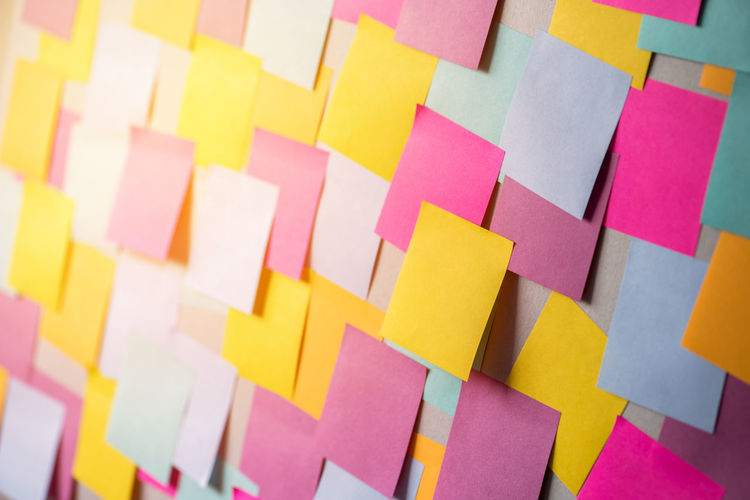Full Frame Shot Of Blank Colorful Adhesive Notes On Bulletin Board