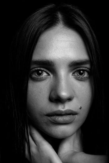 Portrait of a beautiful young girl. Black background for the woman. Low key. Parts of the human body. Expressive eyes. Black and white photography. Studio photo. Low Key Portrait Black Background Woman Blackandwhite Headshot Looking At Camera One Person Young Adult Close-up Young Women Studio Shot Women Indoors  Front View Human Body Part Body Part Beautiful Woman Beauty Adult Real People Human Face Hairstyle Contemplation Teenager