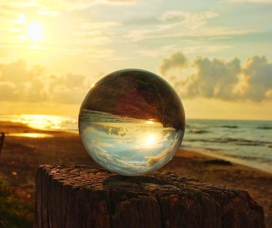 Sphere Crystal Ball Fortune Telling Reflection Sunset Crystal Nature Beach Outdoors Close-up No People Futuristic Sky Water Beauty In Nature Day Galaxy Glassball Glassballs
