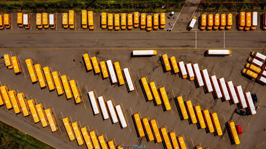 High angle view of yellow flags on road by building
