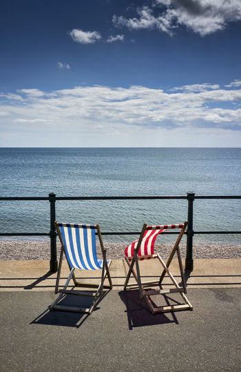 Empty Deck Chairs, Sidmouth, Devon, Britain. Blue Britain Deck Chairs Devon Empty Outdoors Relaxation Scenics Sea Seaside Seat Shore Sky Today's Hot Look Tranquil Scene United Kingdom