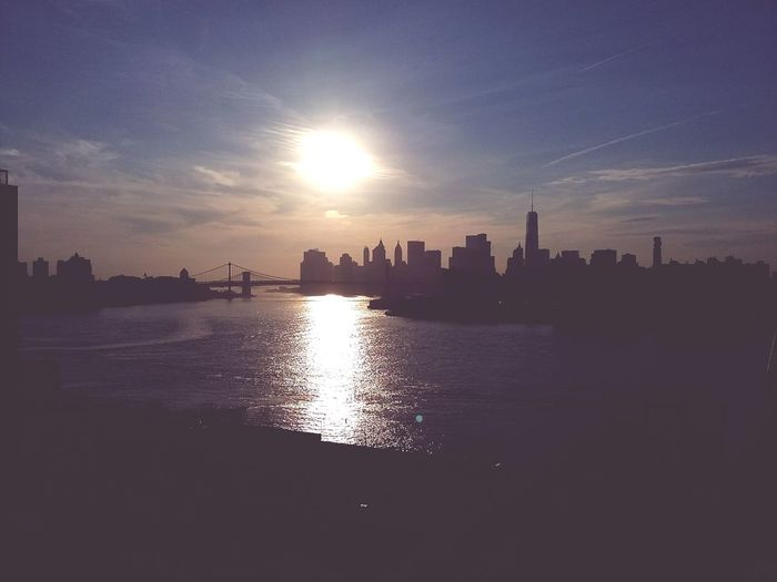 New York Against The Sun. · New York City NYC USA Manhattan Cityscape Skyline Urban Landscape Architecture Highrises From A Bridge Against The Light Sun Water Light And Shadow Silhouettes