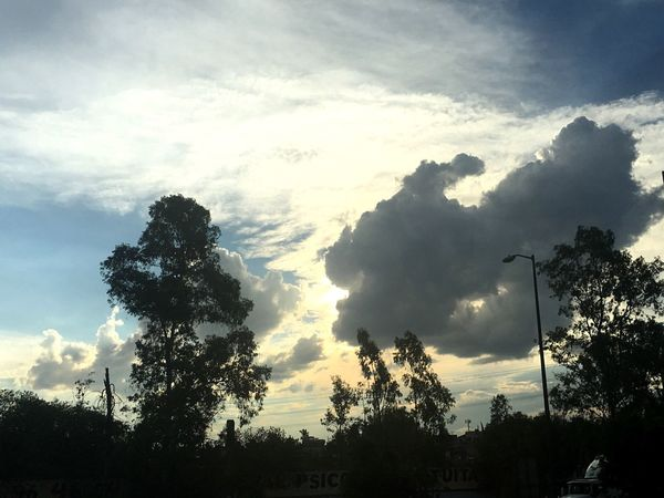 Personajes ... Silhouette Low Angle View Cloud - Sky Tranquil Scene Place Of Heart