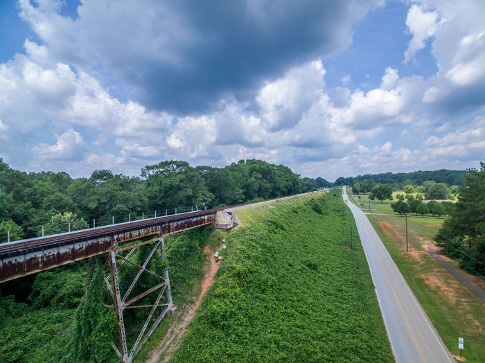 Alcovy Trestle Beauty In Nature Bridge - Man Made Structure Cloud Cloud - Sky Cloudy Connection Day Diminishing Perspective Engineering Grass Green Green Color Growth Landscape Mountain Nature No People Outdoors Plant Scenics Sky The Way Forward Tranquil Scene Tranquility Tree