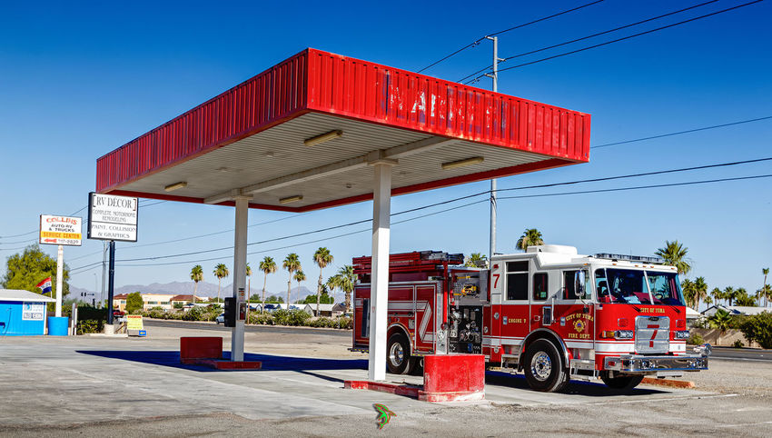 Red Outdoors Fuel Pump Gasoline Day Sky No People Fire Truck Ladder Fire Truck Firefighter Triadic Color Harmony EyeEm Selects Arizona Highways