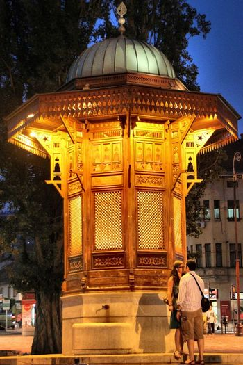 Sarajevo Bosnia And Herzegovina - Fountain Of Love - Travel Bascarsija Wooden Water Night Romantic Two People Kiss Outdoors Togetherness Nightphotography Architecture Light Real People Eye4photography  EyeEm Best Shots Built Structure Tourism