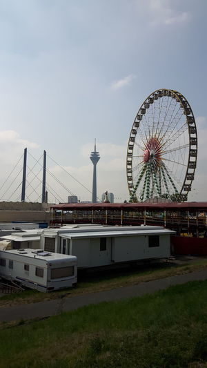 City Ferris Wheel Cityscape Amusement Park Ride Amusement Park Urban Skyline Arts Culture And Entertainment Beach Sky
