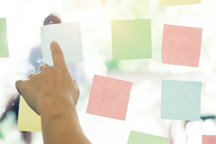 hand using sticky note paper. Close-up Day Hand Human Body Part Human Finger Human Hand Indoors  Memo Note Note Paper One Person Paper Papers People Reminder Sticky Notes