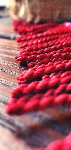 Close-up of red ropes on table