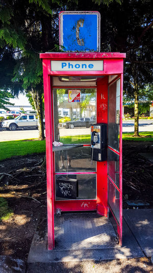 I like phone booths. They were useful and now are relics of our not so distant past. Plant Communication Telephone Telephone Booth Tree No People Nature Day Outdoors Red Technology Pay Phone Architecture Road Built Structure Building Exterior Coin Operated Oldschool Telephony Outdatedtechnology Outdated Tech Relic From The Past Relicsofthepast Memories Memoribilia The Architect - 2018 EyeEm Awards