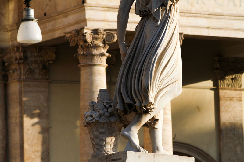 Detail of the statue of the goddess flora, piazza del popolo rome, sunset time.
