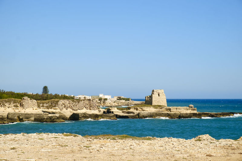 Fort At Beach Against Clear Blue Sky