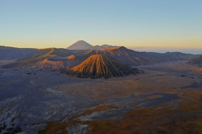 Scenic view of volcano against clear sky during sunset