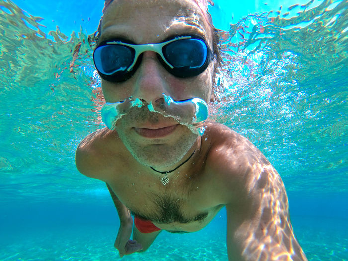 Funny guy having fun and taking underwater selfie while swimming in the sea Swimming Leisure Activity Water Man Males  Sea Eyewear UnderSea Swimming Underwater Ocean Sea Water Blue Transparent Air Bubbles Snorkeling Fun Healthy Lifestyle Summer Vacation Tropical Tropical Paradise Thailand Maldives Phi Phi Island Underwater Selfie