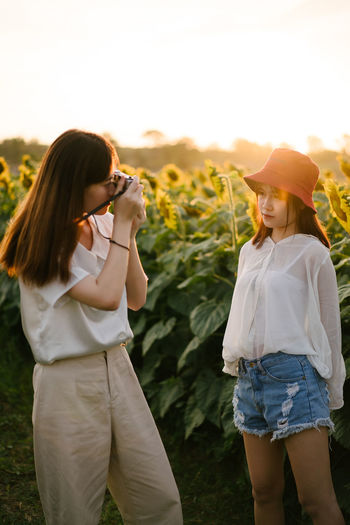 Two brother in the sunflower field Jidpipat_Photo Two People Women Standing Leisure Activity Real People Females Nature Girls Togetherness Family Plant People Lifestyles Focus On Foreground Sunset Positive Emotion Hairstyle Sister Outdoors Couple - Relationship Sunflower Shooting Photos Sunrise Film Camera Capture Tomorrow EyeEmNewHere My Best Photo Humanity Meets Technology