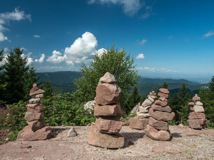 View of rocks on mountain against cloudy sky