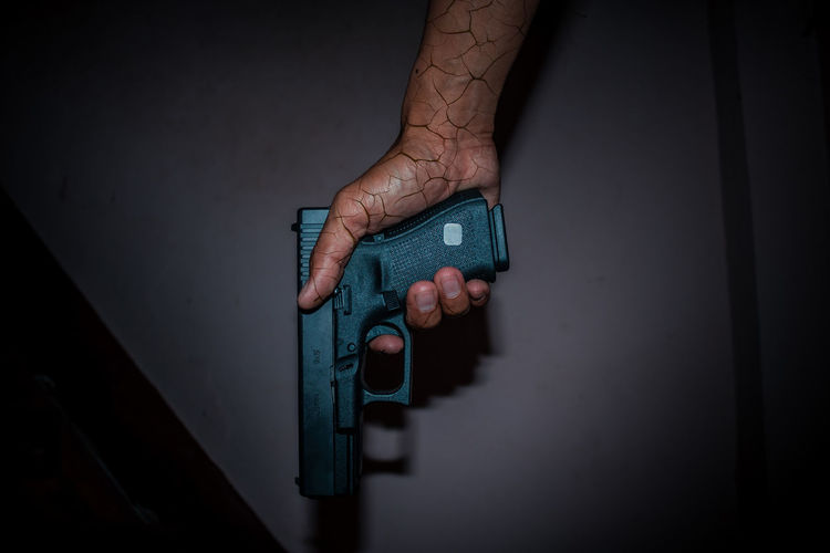 Male hand holding gun on black background.#Glock 19 Gen4. Man Dead Glock19 Glock19gen4 Hand Handgun Killer Killerminimal Scary