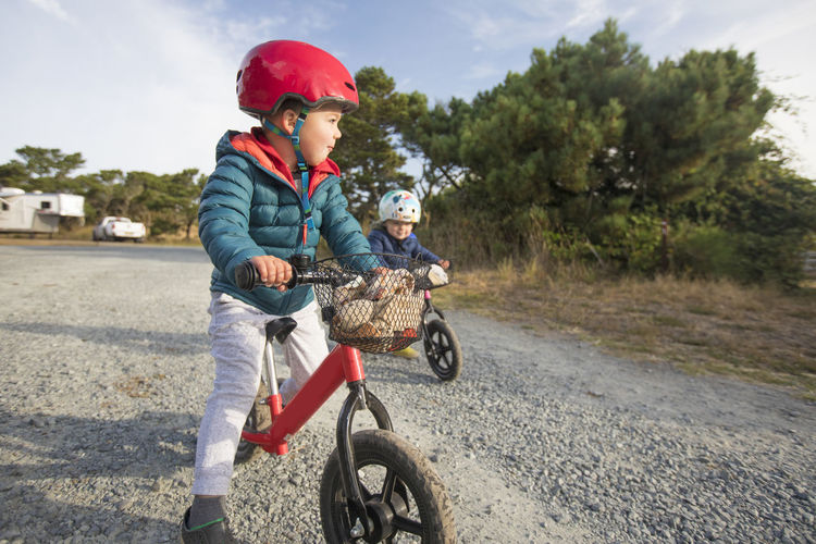 Boy riding bicycle on road