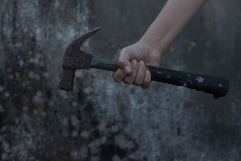 Cropped Hand Holding Hammer