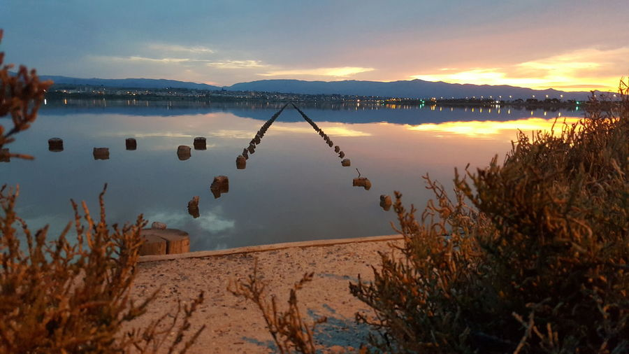 Reflection Sunset Lake Water Outdoors No People Landscape Travel Destinations Scenics Tranquility Agriculture Mountain Nature Sky Beauty In Nature Day Symmetry Sardegna😍😍👍👌 Horizon Over Water Cagliari, Sardinia Flamingo Animal Wildlife Desert Tranquility Nature